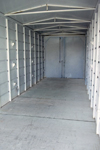 Inside view of storage building with shelving brackets